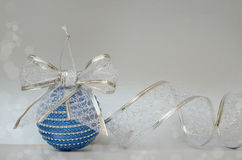 Blue Сhristmas ball and glitter ribbon Stock Photo