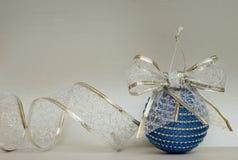 Blue Сhristmas ball and ribbon Stock Image