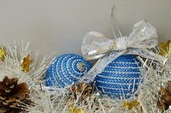 Blue Сhristmas balls, tinsel and pinecones Stock Photos