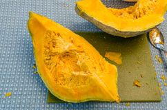 Blue Hubbard squash being prepared Royalty Free Stock Photo