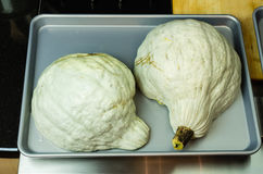 Blue Hubbard squash ready for baking Stock Photo