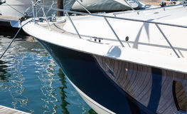 Blue Hull on Yacht. Shiny blue hull on a white yacht in harbor Royalty Free Stock Photography