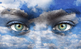 Blue human eyes with sky pattern Royalty Free Stock Photos