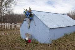 A blue hut in a graveyard, Alberta Royalty Free Stock Photography