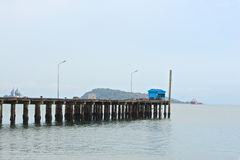 Blue hut on old wooden pier of sea port Royalty Free Stock Photos