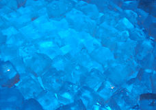 Blue ice. Close up of ice cubes lit by blue light royalty free stock image