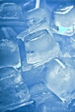 Blue Ice. Close up of some ice cubes toned in blue. Shallow DOF royalty free stock image