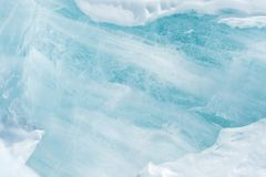 Blue ice abstract natural background. Elements of glacier. Close-up.  royalty free stock images