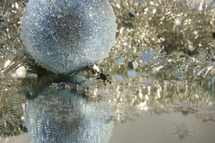 Blue ice ball. Blue ice Christmas ball with tinsel Royalty Free Stock Image