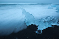Blue Ice On Beach Stock Images