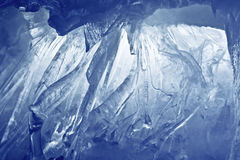 Blue Ice cave. Covered with snow and flooded with light royalty free stock photos