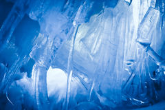 Blue Ice cave. Covered with snow and flooded with light royalty free stock photo