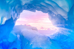 Blue ice cave. Covered with snow and flooded with light royalty free stock photography