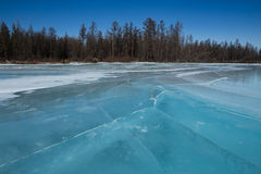 Blue ice cracked on the river. Royalty Free Stock Image