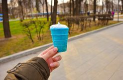 Blue ice cream in hand close up blue ice cream stock images
