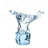 Blue ice cube dropped to water Stock Images