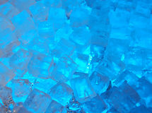 Blue ice cubes. Ice cubes lit by blue light Stock Photo