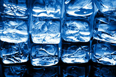 Blue ice cubes royalty free stock photos