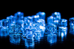 Blue ice cubes on the black background Royalty Free Stock Photos