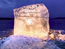 Blue ice cubes shine on flat glacier surface.  Thanks to spot light shine details. Blue ice cubes shine on flat glacier surface.  Thanks to spot light shine Stock Photos