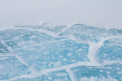 Blue Ice. Deep fissures in the blue ice on a pond in Antarctica that has melted and refrozen multiple times royalty free stock images