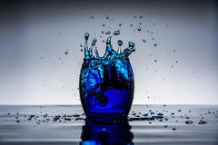 Blue Ice Drop. Highspeed photography using ice and food coloring Stock Photography