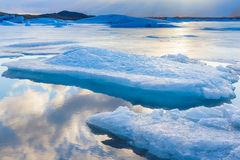 Blue ice floating in Iceland with sky reflexion. Blue icebergs floating in Jokulsarlon lagoon Iceland with sky reflexion stock photos