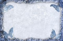 Blue ice framed background with butterflies Stock Photos