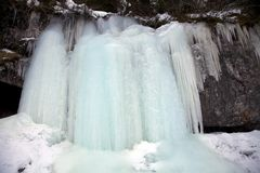 Blue ice in the frozen falls. In the Alps, Dolomites mountains, Italy Royalty Free Stock Photos