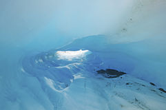Blue Ice in a Glacial Ice Cave. Ice Cave on the Franz Josef Glacier in New Zealand royalty free stock image