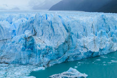 Blue ice glaciar Perito Moreno in Patagonia. Argentina. Deep blue ice blocks of the biggest mountain glacier in the world Stock Photos