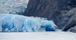 Blue ice glacier ice and lake in Patagonia Royalty Free Stock Image