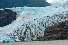 Blue Ice Glacier. Juneau, AK, USA - May 25, 2016: View of the moraine and blue ice of the Mendenhall Glacier royalty free stock photos