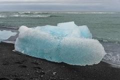 Blue ice at glacier lagoon and black beach on Iceland, summer 20 Royalty Free Stock Photography