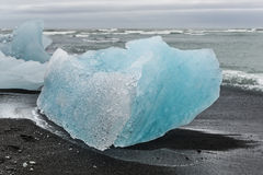 Blue ice at glacier lagoon and black beach on Iceland, summer 20 Royalty Free Stock Photos