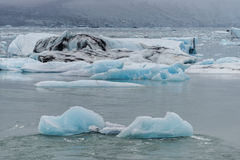 Blue ice at glacier lagoon and black beach on Iceland, summer, 2 Royalty Free Stock Photos