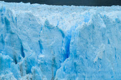 Blue ice glacier Perito Moreno in Patagonia. Argentina. Deep blue ice blocks of the biggest mountain glacier in the world royalty free stock photos