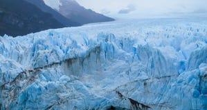 Blue ice glacier Perito Moreno in Patagonia. Argentina. Deep blue ice blocks of the biggest mountain glacier in the world stock image