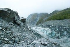 Blue Ice and Gray Rocks of Fox Glacier, New Zealand Stock Photo