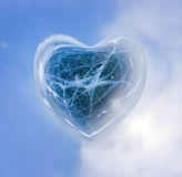 Blue Ice heart with bubbles and cracks isolate Stock Photos