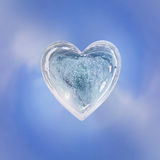 Blue Ice heart with bubbles and cracks isolate Stock Image