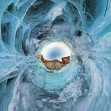 Blue ice of Lake Baikal, the cliffs of the island of Olkhon. Tiny planet 360vr panorama.  royalty free stock photo
