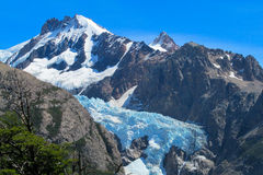 Blue ice mountain glacier Patagonia landscape. Vertical mountain glacier. Blue ice among dark rocks in the high mountains, Patagonia landscape Royalty Free Stock Image