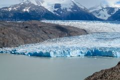 Blue ice patagonian glacier field and lake Stock Images