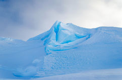Blue Ice Peak in Antarctica. Blue Ice Mountain Peak rising from the ice shelf in Antarctica stock photos