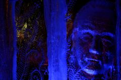 Blue ice sculpture - old man. Winter 2013 Royalty Free Stock Photography