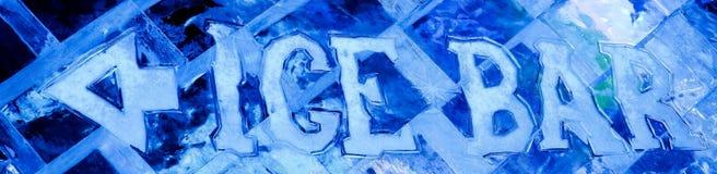 Blue ice sculpture with text ice bar and arrow stock photos
