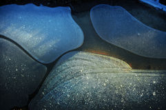 Blue ice shapes. Created on a frozen ground Royalty Free Stock Images
