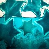 Blue ice stars in water Stock Photo