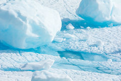 Blue Ice. Water accumulating on a melting iceburg Royalty Free Stock Images